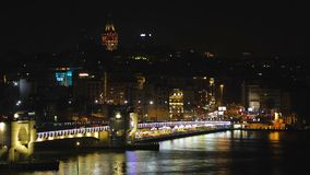 Nightlife of shiny capital of muslim country, illuminated bridge, life in hurry. Stock footage stock video footage