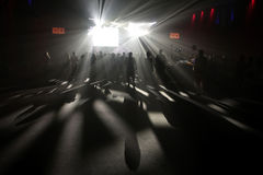 Nightlife. Stage lights cast festival goers silhouette and shadows during live events performances at Sonar Advanced Music Festival in Barcelona Royalty Free Stock Photos