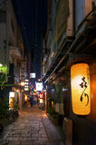 Nightlife on street of Osaka City along with shops, bars, and restaurants decorated with neon signs at night. Osaka, Japan - April 2016: Nightlife on street of Stock Images