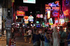 Nightlife on street in thailand. PATTAYA, THAILAND - DECEMBER 13: Nightlife on walking street on December 13, 2013 in Pattaya Stock Image