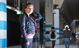 Nightlife: Woman, ready to go out. Young woman at a dark subway station, ready to hit the town and a party. Nightlife scene Royalty Free Stock Photos
