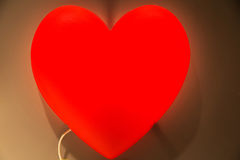 Nightlight in the shape of a heart in the children`s room Royalty Free Stock Photography