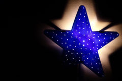 Nightlight in the shape of a star in the children`s room Stock Images