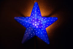 Nightlight in the shape of a star in the children`s room Royalty Free Stock Photos