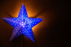 Nightlight in the shape of a star in the children`s room Royalty Free Stock Photo