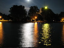 Nightlights on surface. City nightlights reflecting on water surface Royalty Free Stock Photos