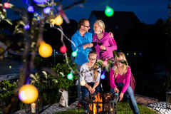 Nightly bbq party of family in their garden Stock Photography