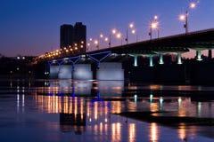 Nightly bridge. Nightly illumination of motor-car bridge stock photo
