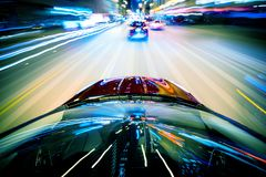 Nightly City Traffic. Motion Blurs. Colorful Urban Illumination in Motion Blur. City Streets Speeding Car Stock Images