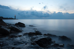 Nightly seascape with lighthouse Stock Photos