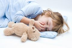 Nightmare. Child with teddy bear, sleeping and crying Royalty Free Stock Photo
