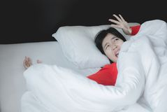 Nightmare or bad dream,Woman with scare and panic while lying down under the blanket in bedroom stock images
