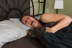 Nightmare in bed. Young woman has bad dreams, nightmare stock photos