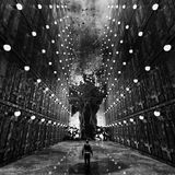 Nightmare Environment Monochrome Concept Art. Monochrome concept art of a man walking into the environment in his nightmare with thousands of doors with lamps on Royalty Free Stock Photo