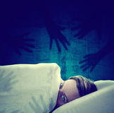 Nightmare. Frightened man can't sleep because of nightmares Royalty Free Stock Photography