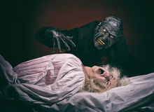 Nightmare. Insane women and her inner monster, dark background Royalty Free Stock Photography