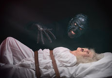 Nightmare. Insane women and her inner monster, dark background Stock Photo