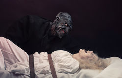 The Nightmare. Insane women and her inner monster, dark background Royalty Free Stock Image