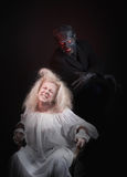 The Nightmare. Insane women and her inner monster, dark background Stock Image