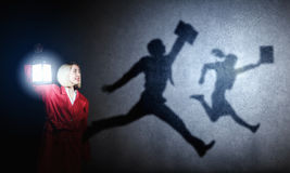 Nightmare. Young blond woman in red cloak with lantern Royalty Free Stock Photos