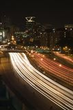 Nightscape of Atlanta, Georgia skyline. Nightscape of Atlanta, Georgia skyline with blurred automobile lights on highway in foreground Royalty Free Stock Image