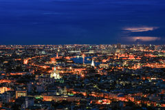 Nightscape of Bangkok,Thailand - with lightning in the sky Stock Photos