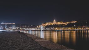Nightscape of Buda Castle and Chain Bridge in Budapest, Hungary. The Chain Bridge is a suspension bridge that spans over the River Danube linking Buda and Pest stock photography