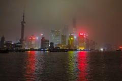 Nightscape of the bund with the fog or mist cover the bund in the winter season,shanghai china. Shanghai/China - January 26 2015: Nightscape of the bund with the royalty free stock photo