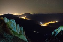 Nightscape over Brasov County, Romania. Nightscape over Brasov County photographed from on top of Bucegi mountains , Romania,in early November royalty free stock images