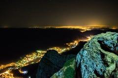 Nightscape over Brasov County, Romania. Nightscape over Brasov County shot from on top of the Bucegi mountains, Romania stock image
