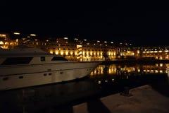 Nightscene. Of building and marina Stock Image