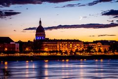 Nightscene of Mainz with moonrise in blue hour royalty free stock images