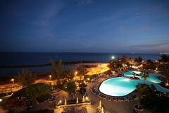 Nightsea view from Hotel. Hotel with blue pool shot at the night royalty free stock photography