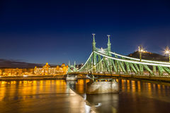 Nightshot at chain bridge on Danube river with lights Royalty Free Stock Photo
