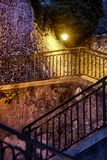 Nightshot of a flight of stairs in the old village of Nice royalty free stock photography
