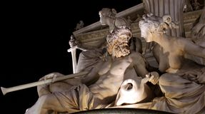 Nightshot sculpture of a man a woman Royalty Free Stock Image