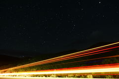 Nightsky Traffic. Time Exposure under Star filled night sky in Boysen State Park in Wyoming, USA Stock Image