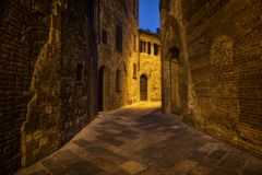 Nighttime ancient street of the city of Montepulciano Stock Photos