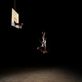 Nighttime basketball player Stock Images