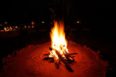 Nighttime campfire. Outdoor wood campfire burning brightly during the darkness of nighttime royalty free stock photo