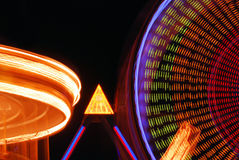 Nighttime Carnival Lights. Rides in motion at a nightime carnival create a blur of fantastic lights and colors Stock Photo