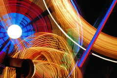 Nighttime Carnival Lights. Rides in motion at a nightime carnival create a blur of fantastic lights and colors Stock Images