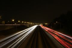 Nighttime city traffic Stock Photos