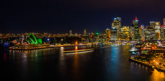 Nighttime Cityscape of Sydney Harbour. Sydney, Australia`s biggest city at nighttime from harbour bridge Royalty Free Stock Photography