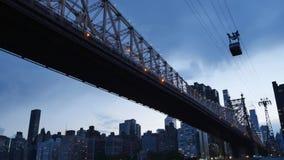 Nighttime Establishing Shot of Ed Koch Queensboro Bridge with Roosevelt Island Tram. A nighttime establishing shot of the Ed Koch Queensboro Bridge between stock video