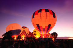 Nighttime hot air balloons Stock Photography