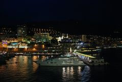 Nighttime kingdom of Monaco. Night view of the port with numerous white yachts in the Kingdom of Monaco stock image