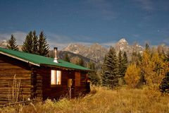 Nighttime log cabin Stock Image