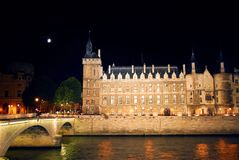 Nighttime Paris. Bridges over Seine and Conciege in nighttime Paris France royalty free stock photography