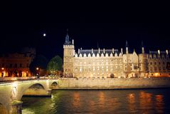 Nighttime Paris. Bridges over Seine and Conciege in nighttime Paris France royalty free stock photo